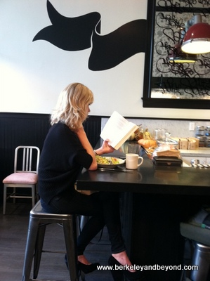 SF-Jane-Fillmore Street-blonde reading at counter-c2011 CaroleTerwilliger Meyers-11-22-11-400pix