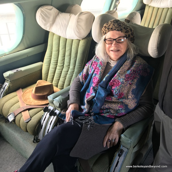 CALIFORNIA-OAKLAND-Oakland Aviation Museum-back yard-flying boat inxterior-Carole in seat next to Indie hat 2-c2018 Gene Meyers-600pix
