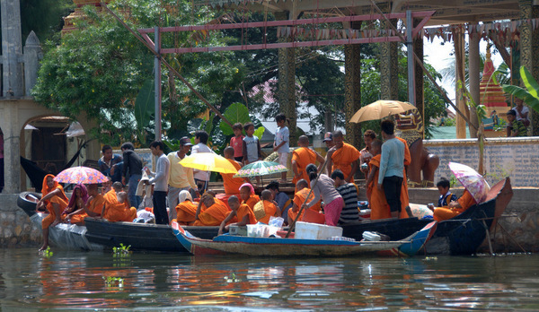 8-monks on Cambodia river cSuzanne Lea Jones-600pix